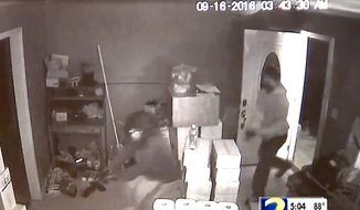 A man bursts through the door of a restaurant manager in Gwinnett County, Georgia, on Friday, Sept. 23, 2016. The home owner repelled him and two others with a personal firearm. One suspect was killed. (WSB-TV 2 ABC Atlanta screenshot)