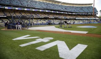Hall of Fame Los Angeles Dodgers broadcaster Vin Scully's initials are painted on the field at Dodger Stadium before the team's baseball game against the Colorado Rockies, Friday, Sept. 23, 2016, in Los Angeles. Scully's final game at the stadium will be Sunday. (AP Photo/Jae C. Hong)