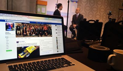U.S. Hispanic Chamber of Commerce spokesman Pablo Manriquez, left, and New Mexico Attorney General Hector Balderas talk on Facebook Live during a Facebook workshop for New Mexico Hispanic small businesses in Albuquerque Friday, Sept. 23, 2016, days after the social media giant announced it is building a new data center in the state. Facebook and the U.S. Hispanic Chamber of Commerce are hosting seminars across the country during Hispanic Heritage Month to show Latino businesses how to have a better presence on Facebook. (AP Photo/Russell Contreras)