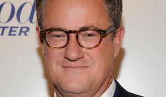 """In this April 11, 2012, file photograph taken by AP Images for The Hollywood Reporter, """"Morning Joe"""" host Joe Scarborough arrives at The Hollywood Reporter 35 Most Powerful People in Media event in New York. (Evan Agostini/AP Images for The Hollywood Reporter, File)"""