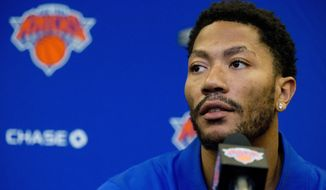 FILE - In this June 24, 2016, file photo, New York Knicks' Derrick Rose speaks during a news conference at Madison Square Garden in New York. Phil Jackson made a risky move when he traded for the injury-prone Rose in June, and now the Knicks face the possibility of their point guard's involvement in a rape trial in California during his first preseason with the team.  (AP Photo/Mary Altaffer, File)