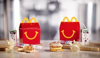 This photo provided by McDonald's shows a breakfast Happy Meal.  McDonald's is considering another addition to its all-day breakfast menu: Happy Meals. The fast-food chain says it will begin testing breakfast Happy Meals in Tulsa, Oklahoma on Sept. 26. The Happy Meals come with either two McGriddles cakes or an egg and cheese McMuffin.(McDonalds via AP)