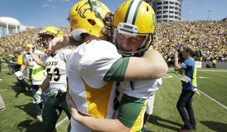 FILE - In this Saturday, Sept. 17, 2016, file photo, North Dakota State kicker Cam Pedersen, right, celebrates with teammate James Fisher after kicking a game-winning 37-yard field goal on the final play of an NCAA college football game against Iowa in Iowa City, Iowa. North Dakota State won 23-21. (AP Photo/Charlie Neibergall)