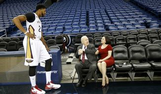New Orleans Pelicans owner Tom Bensons and his wife Gayle Benson greet forward Anthony Davis during NBA basketball media day in New Orleans, Friday, Sept. 23, 2016. (AP Photo/Gerald Herbert)