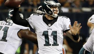 FILE - In this Monday, Sept. 19, 2016, file photo, Philadelphia Eagles quarterback Carson Wentz (11) throws a pass during the first half of an NFL football game against the Chicago Bears in Chicago. Wentz's excellent start is nothing compared to what Ben Roethlisberger did his rookie season. two quarterbacks share an agent and other similarities. They'll meet Sunday when the Philadelphia Eagles  host their intrastate rival Pittsburgh Steelers. (AP Photo/Nam Y. Huh, File