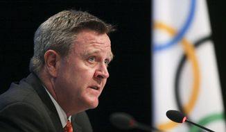 FILE - In this May 24, 2012, file photo, United States Olympic Committee Secretary General Scott Blackmun discusses with the media an agreement between the IOC and the USOC at the SportAccord conference in Quebec City. The U.S. Olympic Committee and the sports it oversees are behind the curve when it comes to placing women and minorities in key coaching and leadership positions, according to a set of ``scorecards'' the federation has compiled over the past three years.  (Francis Vachon/The Canadian Press via AP)