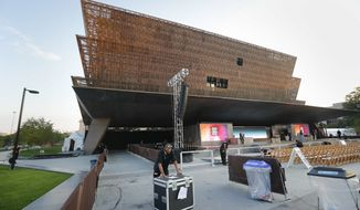 Last minute preparation are made for today's dedication ceremony at the Smithsonian Museum of African American History and Culture on the National Mall in Washington, Saturday, Sept. 24, 2016. (AP Photo/Pablo Martinez Monsivais)