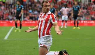 Stoke City's Xherdan Shaqiri appeals to the linesman during the English Premier League soccer match between Stoke City and West Bromwich Albion at the Bet365 Stadium in Stoke, England. Saturday, Sept, 24. (Tim Goode/PA via AP)