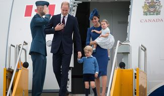 Britain's William and Kate, the Duke and Duchess of Cambridge, along with their children Prince George and Princess Charlotte arrive in Victoria, British Columbia, Saturday, Sept. 24, 2016. (Darryl Dyck/The Canadian Press via AP)