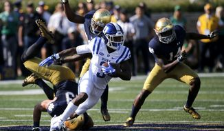 Duke wide receiver T.J. Rahming (3) heads downfield past three Notre Dame defenders after catching a pass from quarterback Daniel Jones during the first half of an NCAA college football game Saturday, Sept. 24, 2016, in South Bend, Ind. (AP Photo/Charles Rex Arbogast)
