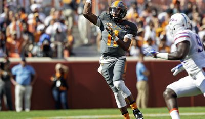 Tennessee quarterback Joshua Dobbs (11) throws to a receiver during the first half of an NCAA college football game against Florida Saturday, Sept. 24, 2016, in Knoxville, Tenn. (AP Photo/Wade Payne)