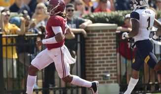Alabama quarterback Jalen Hurts runs the ball in for a touchdown in the first half during an NCAA college football game against Kent State, Saturday, Sept. 24, 2016, in Tuscaloosa, Ala. (AP Photo/Brynn Anderson)