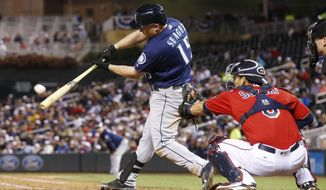 Seattle Mariners' Kyle Seager hits an RBI double off Minnesota Twins pitcher Buddy Boshers during the seventh inning of a baseball game Friday, Sept. 23, 2016, in Minneapolis. (AP Photo/Jim Mone)