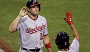 Washington Nationals' Ryan Zimmerman, left, celebrates with Anthony Rendon after scoring on a bases-loaded walk by Jayson Werth off Pittsburgh Pirates relief pitcher Jared Hughes in the sixth inning of a baseball game in Pittsburgh, Friday, Sept. 23, 2016. (AP Photo/Gene J. Puskar)