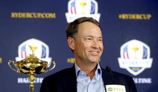 FILE - In this Feb. 24, 2015, file photo, Davis Love III smiles during a news conference introducin him as the 2016 U.S. Ryder Cup captain, at PGA of America in Palm Beach Gardens, Fla. The last Ryder Cup felt like the last straw for the Americans. After yet another loss to Europe, the Americans created a task force to try to find the best captain, to develop the best process for picking a team to have the best chance at winning. (Bill Ingram/Palm Beach Post via AP, File