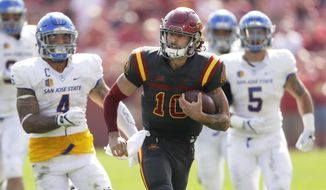 Iowa State quarterback Jacob Park (10) runs from San Jose State linebacker Christian Tago, left, and linebacker Frank Ginda, right, during the first half of an NCAA college football game, Saturday, Sept. 24, 2016, in Ames, Iowa. (AP Photo/Charlie Neibergall)