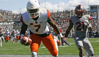 Syracuse's Amba Etta-Tawo (7) catches a touchdown over the defense of Connecticut's Jamar Summers (21) during the first half of an NCAA football game at Pratt & Whitney Stadium at Rentschler Field, Saturday, Sept. 24, 2016, in East Hartford, Conn. (AP Photo/Stew Milne)