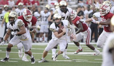Wake Forest quarterback John Wolford (10) finds a hole in the Indiana line for a touchdown during an NCAA college football game, Saturday, Sept. 24, 2016 in Bloomington, Ind.  (Chris Howell/The Herald-Times via AP)