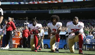 San Francisco 49ers Eli Harold (58), Colin Kaepernick (7) and Eric Reid (35) kneel during the national anthem before an NFL football game against the Seattle Seahawks, Sunday, Sept. 25, 2016, in Seattle. (AP Photo/Ted S. Warren)