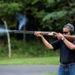 "making a point: The White House released a photograph in 2013 of President Obama skeet shooting at Camp David, but there is no evidence to back up his claim that he did it ""all the time."" (Associated Press)"