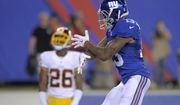 New York Giants wide receiver Odell Beckham Jr. celebrates his touchdown as Washington Redskins cornerback Bashaud Breeland (26) looks on during the second half an NFL football game Thursday, Sept. 24, 2015, in East Rutherford, N.J. (AP Photo/Bill Kostroun)