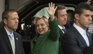 Democratic presidential candidate Hillary Clinton waves as she arrives for a meeting with Israeli Prime Minister Benjamin Netanyahu in New York, Sunday, Sept. 25, 2016. (AP Photo/Matt Rourke)