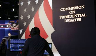 A sounds technician tests his equipment during a rehearsal for the presidential debate between Republican presidential candidate Donald Trump and Democratic presidential candidate Hillary Clinton at Hofstra University in Hempstead, NY, Sunday, Sept. 25, 2016. (AP Photo/David Goldman)