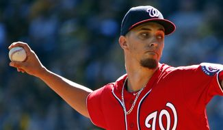 Washington Nationals starting pitcher A.J. Cole delivers in the first inning of a baseball game against the Pittsburgh Pirates in Pittsburgh, Sunday, Sept. 25, 2016. (AP Photo/Gene J. Puskar)