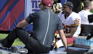 Washington Redskins cornerback Bashaud Breeland (26) is carted off the field during the first half of an NFL football game against the New York Giants Sunday, Sept. 25, 2016, in East Rutherford, N.J.  (AP Photo/Bill Kostroun)