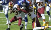 New York Giants running back Shane Vereen (34) is tackled by Washington Redskins' David Bruton (30) and DeAngelo Hall (23) during the first half of an NFL football game Sunday, Sept. 25, 2016, in East Rutherford, N.J.  (AP Photo/Bill Kostroun)