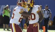 Washington Redskins' Chris Thompson (25) celebrates with teammate Jamison Crowder (80) during the second half of an NFL football game after Crowder scored a touchdown Sunday, Sept. 25, 2016, in East Rutherford, N.J. (AP Photo/Bill Kostroun)