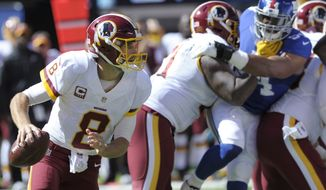 Washington Redskins quarterback Kirk Cousins looks to pass during the first half of an NFL football game New York Giants Sunday, Sept. 25, 2016, in East Rutherford, N.J.  (AP Photo/Bill Kostroun)