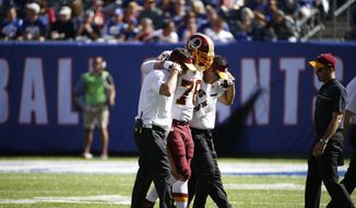Washington Redskins center Kory Lichtensteiger (78) is helped off the field during the second half of an NFL football game against the New York Giants Sunday, Sept. 25, 2016, in East Rutherford, N.J. (AP Photo/Kathy Willens)