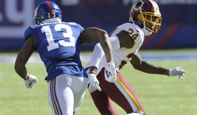 Washington Redskins cornerback Josh Norman (24) defends New York Giants' Odell Beckham (13) during the second half of an NFL football game Sunday, Sept. 25, 2016, in East Rutherford, N.J. (AP Photo/Bill Kostroun)