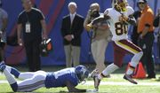 Washington Redskins wide receiver Jamison Crowder (80) breaks away from New York Giants' Trevin Wade (31) to score a touchdown during the second half of an NFL football game Sunday, Sept. 25, 2016, in East Rutherford, N.J. (AP Photo/Bill Kostroun)
