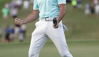Rory McIlroy reacts after sinking a putt on the fourth hole of a playoff with Kevin Chappell to win the Tour Championship golf tournament and the FedEx Cup at East Lake Golf Club, Sunday, Sept. 25, 2016, in Atlanta. (AP Photo/John Bazemore)