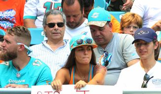A Miami Dolphins fans remembers Miami Marlins pitcher Jose Fernandez with a sign during the first half of an NFL football game against the Cleveland Browns, Sunday, Sept. 25, 2016, in Miami Gardens, Fla. Fernandez died in a boating accident early Sunday morning.  (AP Photo/Marta Lavandier)