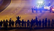 FILE - In this Thursday, Sept. 22, 2016 file photo, protesters block I-277 during a third night of unrest following Tuesday's police fatal shooting of Keith Lamont Scott in Charlotte, N.C. Protesters who have filled the streets to push for the release of video of Scott's shooting could see their task get much harder if Charlotte authorities do not share the footage within a week. A North Carolina law that takes effect Oct. 1 will declare that the video is not a public record and that only a judge can release it. (AP Photo/Gerry Broome, File)