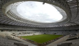 FILE - In this Wednesday, Sept. 7, 2016 file photo, a view of the Luzhniki stadium, which is undergoing a major rebuild to be ready to host the 2018 World Cup final, in Moscow, Russia. FIFA has disbanded its anti-racism task force, declaring the work complete despite ongoing concerns about discriminatory behavior in 2018 World Cup host Russia. (AP Photo/Ivan Sekretarev, File)