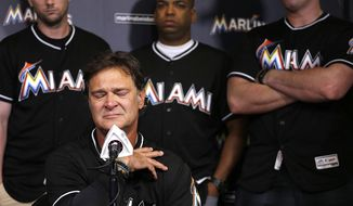 Miami Marlins manager Don Mattingly struggles with his emotions as he speaks during the team's press conference about the death of Jose Fernandez, Sunday, Sept. 25, 2016, after the announcement of the death of their star pitcher, Fernandez, in an early morning boat accident Sunday, in Miami Beach. (Carl Juste/Miami Herald via AP)