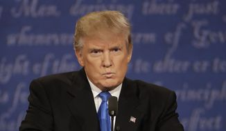 Republican presidential nominee Donald Trump listens to Democratic presidential nominee Hillary Clinton during the presidential debate at Hofstra University in Hempstead, N.Y., Monday, Sept. 26, 2016. (AP Photo/Patrick Semansky)