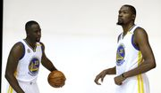 Golden State Warriors' Draymond Green, left, and Kevin Durant pose for photos during NBA basketball media day Monday, Sept. 26, 2016, in Oakland, Calif. (AP Photo/Marcio Jose Sanchez)