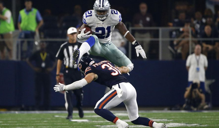 Dallas Cowboys Running Back Ezekiel Elliott 21 Leaps Over A Tackle Attempt By Chicago Bears