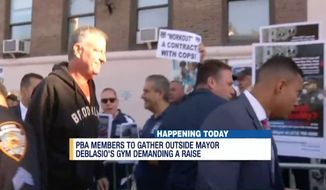 Dozens of New York City police officers hurled demands and booed at Mayor Bill de Blasio on his way into a Brooklyn gym Monday morning. (News 12)