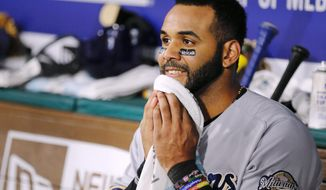 Milwaukee Brewers Jonathan Villar (5) looks on from the dugout after hitting his second two-run home run of the game during the seventh inning of a baseball game against the Texas Rangers on Monday, Sept. 26, 2016, in Arlington, Texas. (AP Photo/Brandon Wade)