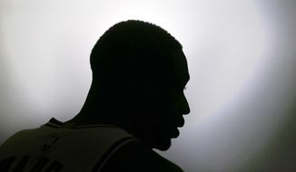 Chicago Bulls' Dwyane Wade sits in silhouette during an interview at the NBA basketball team's media day Monday, Sept. 26, 2016, in Chicago. (AP Photo/Charles Rex Arbogast)