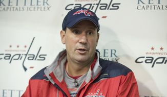 Washington Capitals' assistant coach Todd Reirden speaks to reporters during the first day of NHL hockey training camp in Arlington, Va., Friday, Sept. 23, 2016. (AP Photo/Manuel Balce Ceneta)