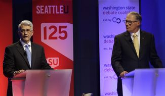 Washington Gov. Jay Inslee, right, a Democrat, and his Republican challenger, Bill Bryant, left, take part in a debate, Monday, Sept. 26, 2016, in Seattle. (AP Photo/Ted S. Warren)
