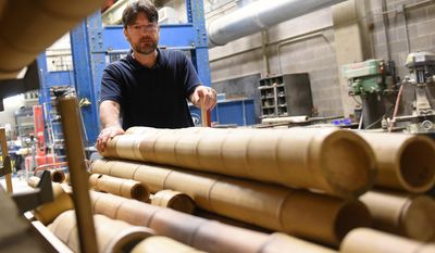 In this Friday, Sept. 15, 2016 photo, University of Pittsburgh professor Kent Harries jostles bamboo samples on campus in Oakland, Pa.  (Sean Stipp /Pittsburgh Tribune-Review via AP)