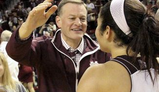 FILE - In this Jan. 28, 2016, file photo, Mississippi State athletic director Scott Stricklin congratulates Dominique Dillingham following the team's NCAA college basketball game against Tennessee in Starkville, Miss. A person familiar with the search says Florida has hired Stricklin as its new athletic director. Stricklin replaces Jeremy Foley, one of the most tenured sports executives in the country. Foley is retiring Saturday after 40 years with the Gators, including the last 25 in charge of Florida's athletic program. The person spoke to The Associated Press on the condition of anonymity because Florida has an announcement and introductory news conference planned for Tuesday, Sept. 27. (AP Photo/Jim Lytle, File)